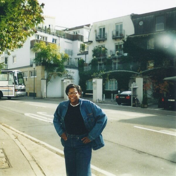 Tracy Taylor standing on the sidewalk in South America